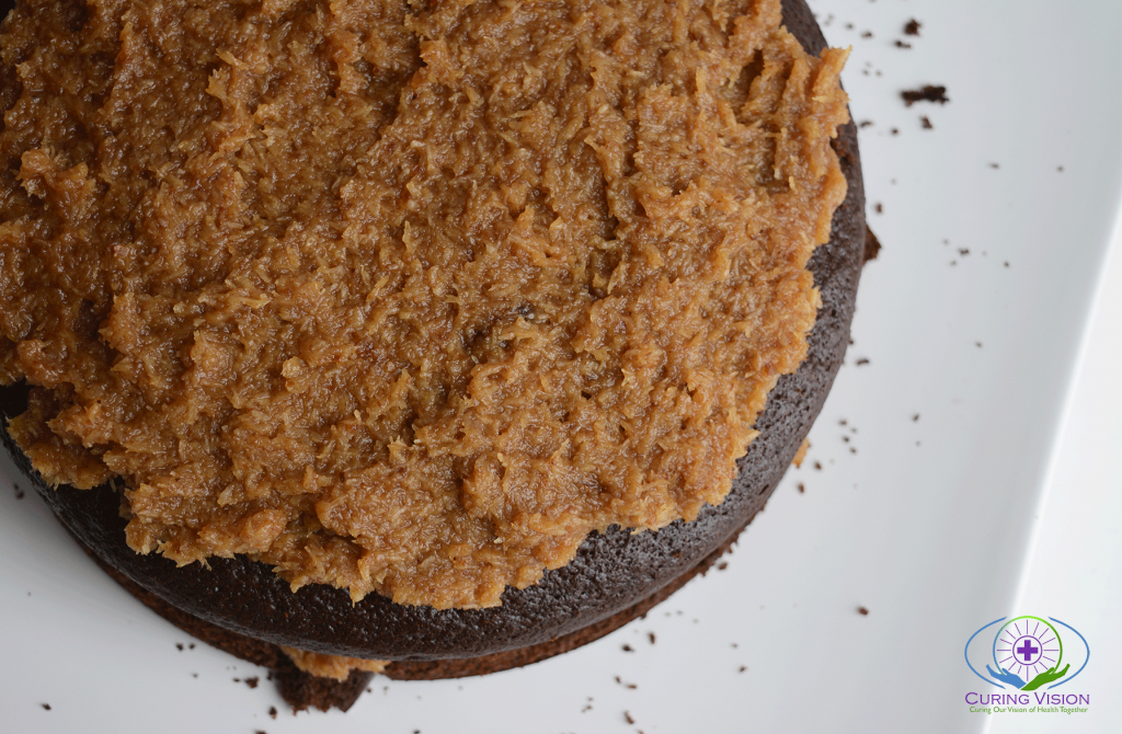 The Best German Chocolate Cake with Low Sugar Frosting. Made with whole food ingredients, pitted dates, coconut sugar, fair trade cocoa, suitable for the alkaline diet, dairy free, nut free, and high in fiber.