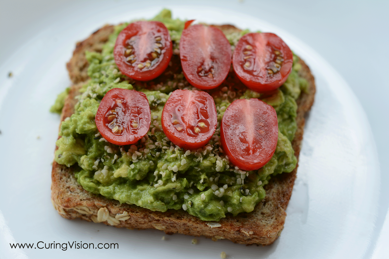 HAT Toast - Hemp Avocado Tomato. This is a complete family approved meal for the Alkaline Diet, Vegan, Whole Foods. We all love the classic BLT sandwich, this is a new healthy twist and fun name! #alkalinediet #avocado #avocadotoast #wholefoods #kroger #familymeal #kidapproved #easydinner #quicklunch